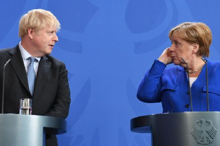 Boris Johnson holds a joint press conference with German Chancellor Angela Merkel in Berlin on Wednesday