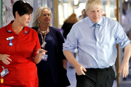 Prime Minister Boris Johnson visited an NHS hospital today. (Photo: Peter Nicholls - WPA Pool/Getty Images)