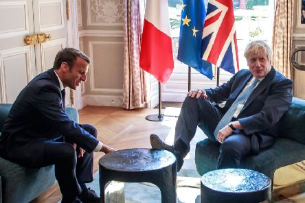 While the media focused on whether Johnson's foot on Macron's table was an insult or not, the futility of the Prime Minister's blustering diplomacy was obscured. Picture: Christophe Petit Tesson/Getty
