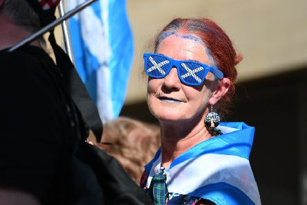 A Yes supporter on an independence rally. Pic: John Devlin