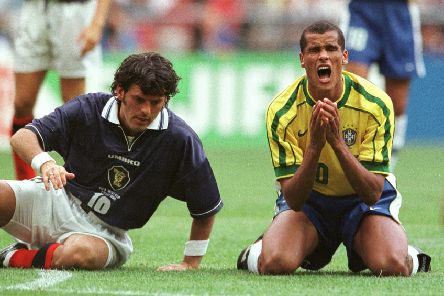 Scotland's Darren Jackson and Rivaldo during the opening game of the 1998 World Cup. Picture: Laurent Rebours/AP