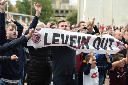 Hundreds of Hearts fans gather outside the main stand after Saturday's 3-2 defeat by Motherwell to protest against manager Craig Levein. Picture: SNS.