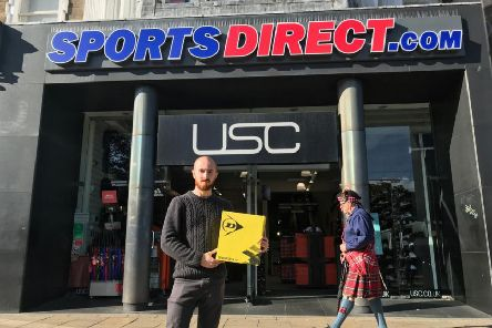 Aeden Cormack outside the Sports Direct store with his boots.