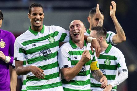 Celtic pair Scott Brown and Christopher Jullien celebrate the Europa League play-off win against AIK. Picture: Craig Williamson/SNS