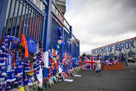 Rangers fans leave tributes at the gates of Ibrox  after the death of club idol Fernando Ricksen
