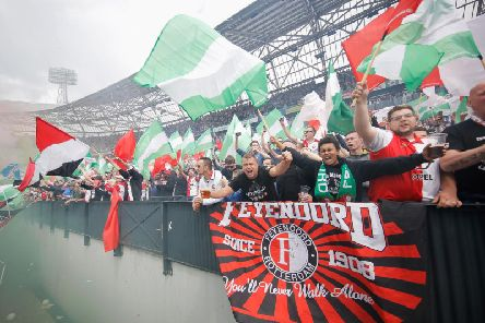 Feyenoord fans with a banner reading 'You'll Never Walk Alone'