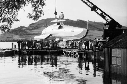 John Cobb watches his speedboat Crusader being lifted from Loch Ness in 1952. Cobb died the next day while attempting - and briefly accomplishing - the world water speed record.