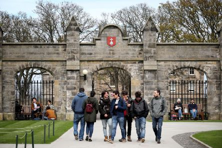 Students gather outside the entrance to the Lower and Upper College Halls at the University of St Andrews