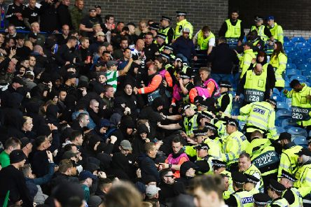 Feyenoord fans clash with police officers at Ibrox