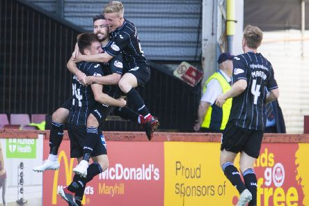 Ryan Dow is mobbed by his team-mates as they celebrate his goal, the second  for Dunfermline. Photograph: Bill Murray/SNS