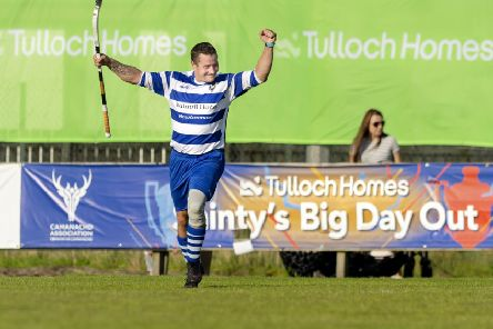 Newtonmore's Glen MacKintosh celebrates one of his two goals in the Camanachd Cup final win over Oban Camanachd. Picture: Neil G Paterson