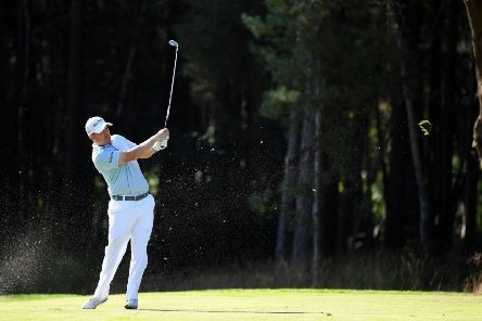 Richie Ramsay plays his second shot on the 13th hole at Wentworth. Picture: Ross Kinnaird/Getty Images
