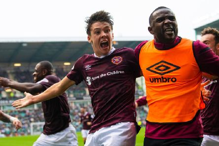 Hearts defender Aaron Hickey celebrates his winning goal. Picture: SNS