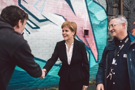 First Minister Nicola Sturgeon visited the SWG3 Yardworks Railway Arch project for a lesson in graffiti art. Picture: PA