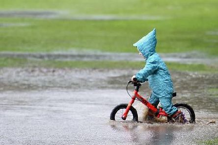 Some people don't mind the bad weather as much as others! Picture: Neil Hanna