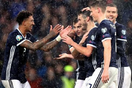 John McGinn is congratulated after netting his, and Scotland's, third