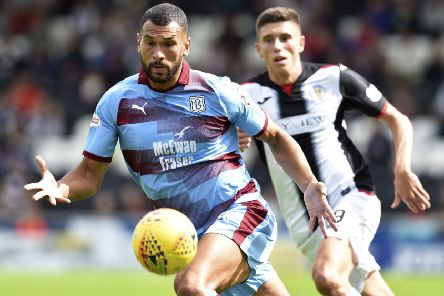 Steven Caulker, left, in action for Dundee in 2018. Picture: SNS