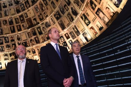 Prince William, with Chief Rabbi Ephraim Mirvis of the United Congregations of the Commonwealth (left) and chairman of Yad Vashem, Avner Shalev, right, tour the Yad Vashem Holocaust memorial in Jerusalem. (Picture: Debbie Hill/AFP/Getty Images)