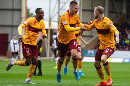 James Scott celebrates with his Motherwell team-mates after putting the Fir Park side 1-0 up against St Mirren.