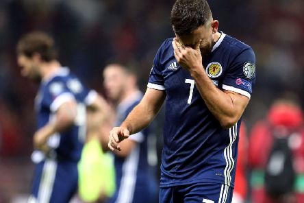 Robert Snodgrass cuts a dejected figure after Scotland's 4-0 defeat in Moscow.