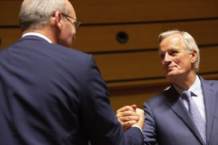 Brussels' chief negotiator Michel Barnier with Irish Foreign Minister Simon Coveney. Picture: AP