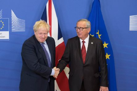 Done deal? Boris Johnson and Jean-Claude Juncker, President of the European Commission, shake hands  (Picture: Stefan Rousseau/PA Wire)