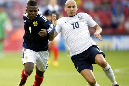 Islam Feruz takes on Jonjo Shelvey in an under-21 friendly between Scotland and England at Bramall Lane in Sheffield in 2013. Picture: Bill Murray/SNS