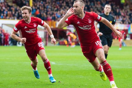Niall McGinn wheels away in celebration after netting Aberdeen's second of the afternoon