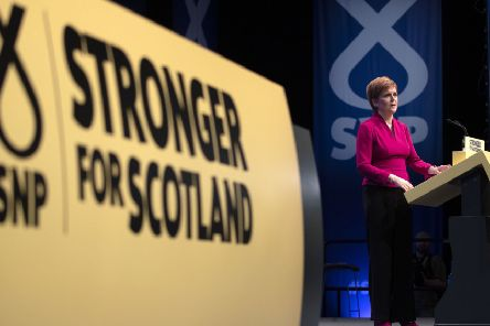 First Minister of Scotland Nicola Sturgeon delivers her keynote speech to delegates during the SNP autumn conference. Picture: Jane Barlow/PA Wire
