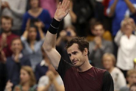 A tearful Andy Murray salutes the crowd after winning the European Open final