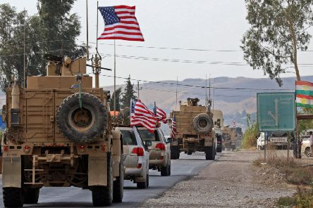 A convoy of US military vehicles arrives near the Iraqi Kurdish town of Bardarash, Dohuk, on Monday, after withdrawing from northern Syria (Picture: Safin Hamed/AFP via Getty Images)