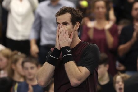 Andy Murray seems scarcely able to believe that he has beaten Stan Wawrinka to lift the European Open trophy. Picture: Francisco Seco/AP
