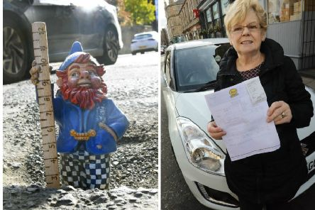 Pothole Pete was on hand to measure the extent of the hole. Theresa Muldoon was left with a repair bill after bursting her tyre. Picture: JPIMedia