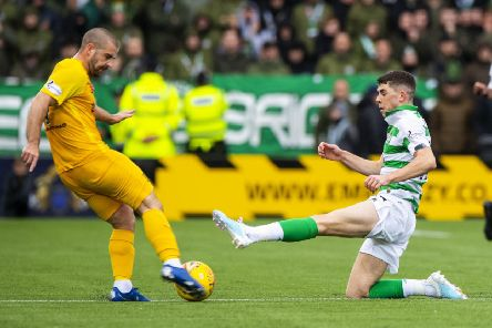 Celtic's Ryan Christie slides into a challenge on Livingston's Scott Robinson which earned a straight red card. Picture: Alan Harvey/SNS
