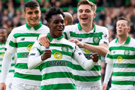 Jeremie Frimpong celebrates James Forrest's goal in the 6-0 victory over Ross County on Saturday. Picture: SNS