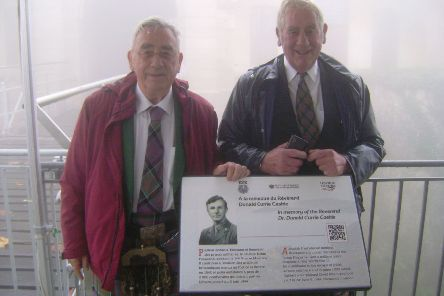 Tom Caskie (left) and his brother Gordon with a memorial plaque marking the work of Rev Dr Donald Caskie which has been unveiled at Fort de la Revere near Nice. PA Photo