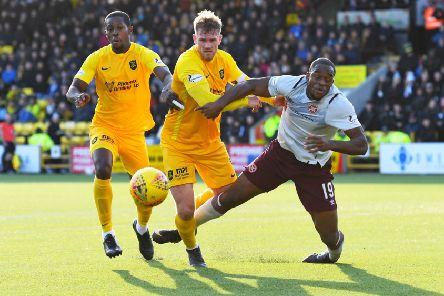 Hearts striker Uche Ikpeazu and Livingston's Alan Lithgow tangle in the box during the 1-1 draw. Picture: SNS.
