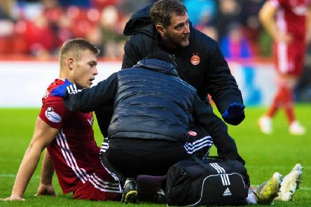Sam Cosgrove was forced off through injury for Aberdeen. Picture: SNS