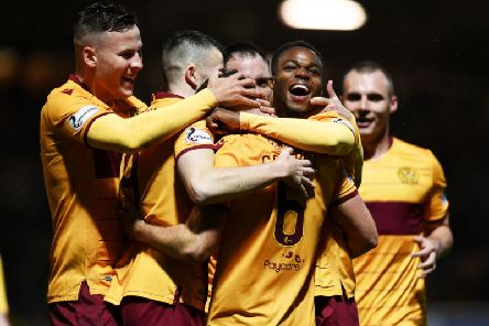 Allan Campbell is mobbed by team-mates after netting a late winner for Motherwell. Picture: SNS