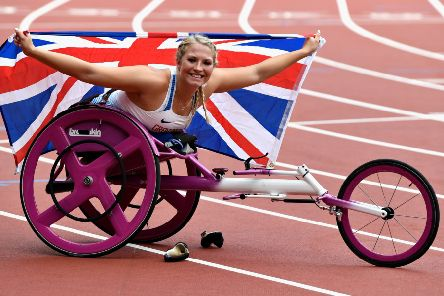 Sammi Kinghorn of Great Britain celebrates after winning gold in the Womens 100m T53 final at the 2017 World ParaAthletics Championships in London. Picture: Mike Hewitt/Getty Images