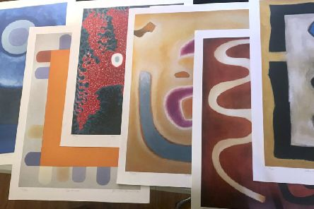 Some of the Benjamin Creme artwork that Los Angeles Police detectives have recovered.