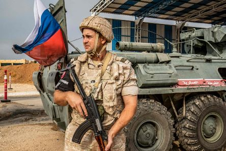 A member of the Russian military police stands outside an armoured personnel carrier at a position along the Syria-Turkey border. James Le Mesurier, who was found dead, helped found the White Helmets volunteer organisation in Syria. Picture: Delil Souleiman/Getty Images