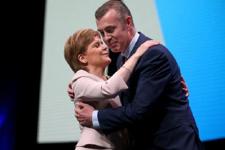 Nicola Sturgeon embraces Plaid Cymru leader Adam Price after he spoke at the SNP conference in October 2018. Picture: PA