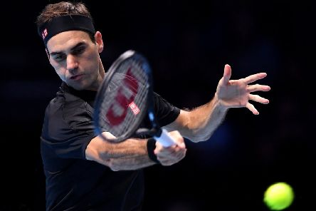 Roger Federer plays a forehand in the win over Matteo Berrettini. Picture: Justin Setterfield/Getty Images