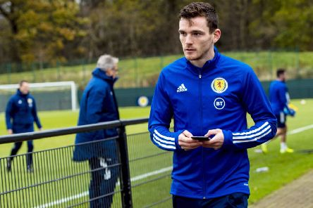 Andy Robertson will remain with the Scotland suad until they fly out to Cyprus. Picture: Craig Williamson/SNS