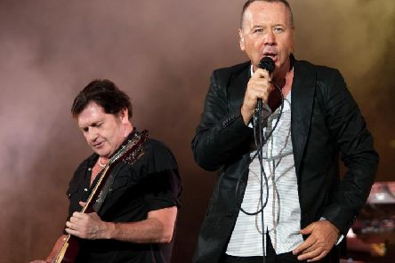 Simple Minds vocalist Jim Kerr performs with guitarist Charlie Burchill. Picture: GettyImages