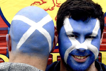 Independence campaigners take part in an ''All Under One Banner march in Edinburgh (Picture: Lisa Ferguson)