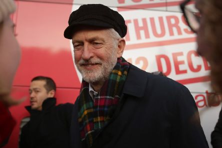 Jeremy Corbyn campaigns in Linlithgow, wearing a cap rather than a fez (Picture: David Cheskin/Getty Images)