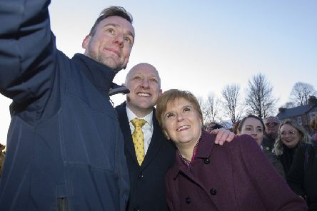 Nicola Sturgeon and SNP candidate Calum Kerr posing for a selfie in Hawick this week. Picture: Bill McBurnie