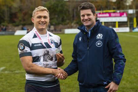 Iain Wilson receives his Man of the Match award from Scottish Rugby's chief operating officer Dom McKay.  following Heriot's victory over Ayrshire Bulls last week. Photograph: Gary Hutchison/SNS/SRU.
